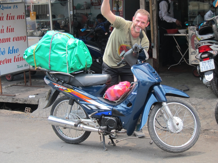 A biker buy amotorbike sale at Travel Swop Shop